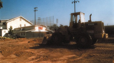 The ball game was over for the women's softball team January 2000 when a 91-space parking lot opened on its location. The original field, which never met NCAA mandates for right field, was replaced by a city owned field at Wheeler Avenue and First Street. Construction began in September after weighing the off-campus consequences. / photo by Isela Peña