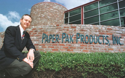 Griff Hopkins is dwarfed by the towering business he has helped to build. As the Chief Executive Officer of Paper-Pak, Hopkins has helped to turn Paper-Pak into a corporation that annually brings in $100 million in profits. / photo by Ryan Sones