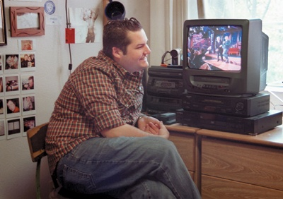 Ross Mathews watches his past performances in his ULV Oaks dorm room. He says he receives all of his appearances on tape from the show's studio. / photo by Amy Babin