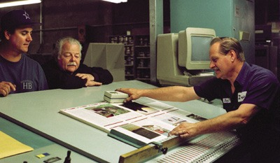 Coach of his shop, owner Dick Zahniser (middle) believes in sharing responsibility and recreation with his employees, such as General Manager Pete Marrugi (left) and Jim Pearson, the head press man (right). The loyal bond has developed over 13 years with company-shared fishing trips and other social events. The small printing shop turns out books, pamphlets and La Verne Magazine. Zahniser has diversified to refurbishing printing presses and has started a sound studio. / photo by Summer Herndon