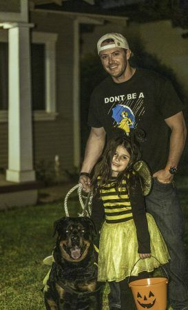 James Janclaes and daughter Holly Janclaes plus family rottweiler Enzo enjoy a sweet Halloween night out together trick or treating. / photo by Mya-Lin Lewis
